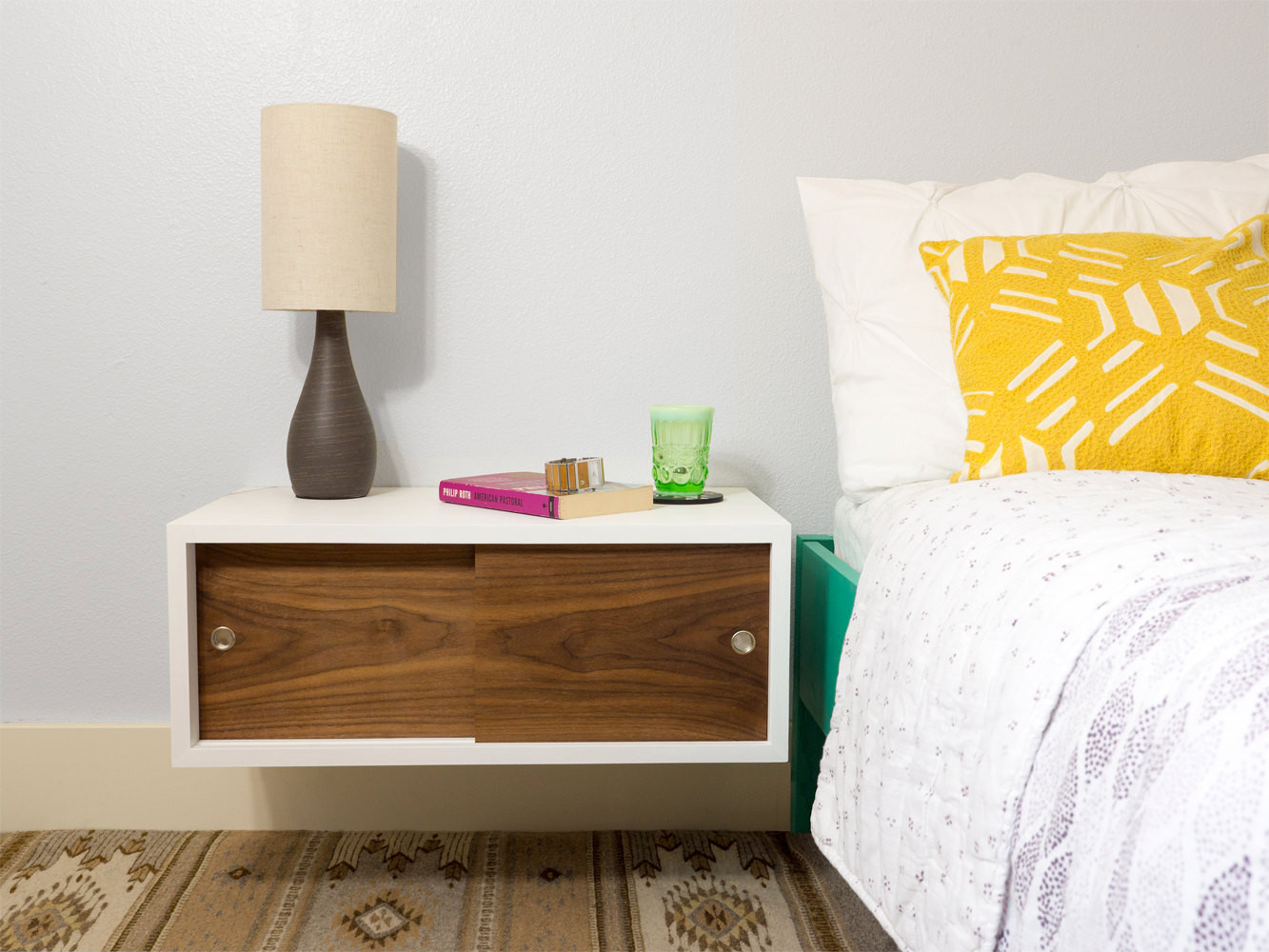 floating nightstand with sliding doors
